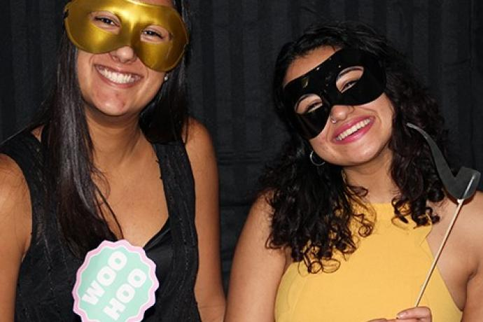 Two girls with a mask.